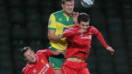 Norwich Citys U21s captain Ryan Bennett heads the ball away while palying against Liverpools U21s te