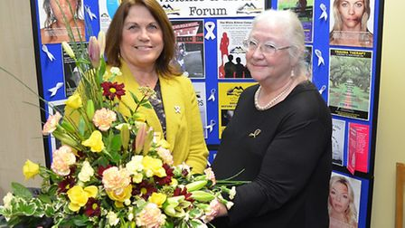 Maureen Duckworth (Coordinator) being presented with retirement flowers by Drena Black, Chair of Tr