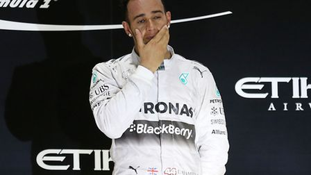 Lewis Hamilton tries to let it all sink in on the Abu Dhabi podium.