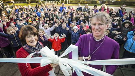 Mundford Primary School converts to an Acadmey, with the Bishop of Lynn Jonathan Meyrick (right) cut