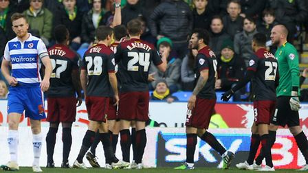 Bradley Johnson pleads his innocence after a conceding a penalty in Norwich City's 2-1 Championship