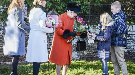 The Queen recieves flowers after morning service last Christmas Day. Picture: Matthew Usher.
