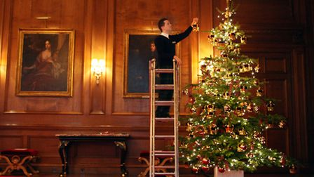 A tree being decorated at a Royal residence. Members of the Royal Family helped popularise Christmas