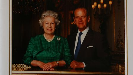 A Christmas card from the Queen and Duke of Edinburgh, dated 1997.