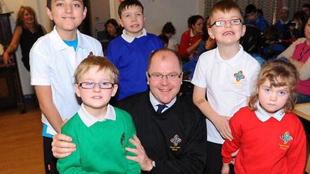 Mid-Norfolk MP George Freeman and youngsters at Chapel Road School in Attleborough, modelling jumper