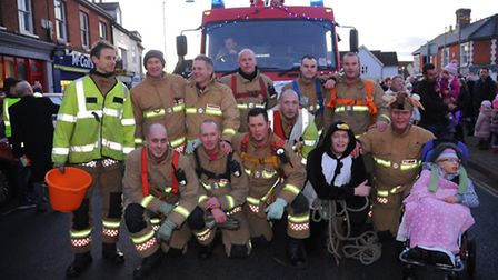 Attleborough Christmas Lights go on 2014Firefighters from the town pull an engine around the one way