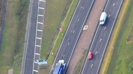 Old and the new - the old A11 single carriageway to the left of the soon to open dual carriageway El
