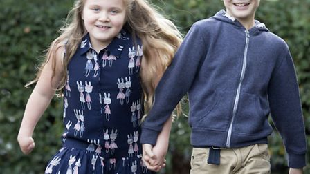 Grace Matthews' brother, Thomas, nine, helps Grace to walk wearing her new blades for the first tim