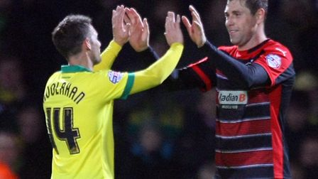 Grant Holt and Wes Hoolahan embrace at the end of the game. Paul Chesterton / Focus Images