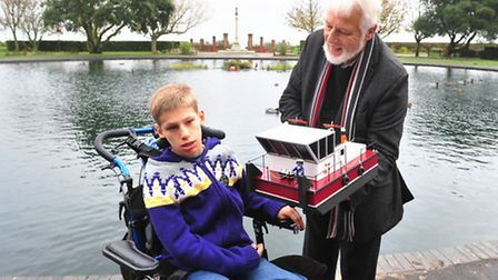Felix Scase-Jones, being presented with his very own model boat by Bryan Ball and Lowestoft Model B