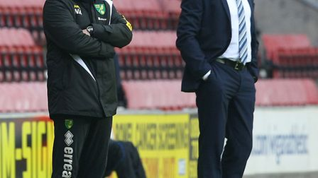 Norwich manager Neil Adams and Wigan Athletic counterpart Malky Mackay prowl the touchline at the DW
