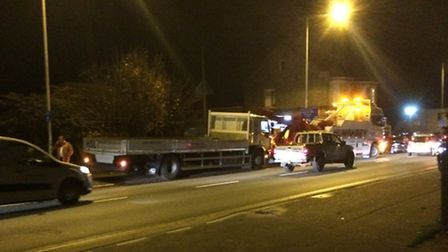 A lorry sunk into the pavement in Victoria Road in Diss, leaving behind two large holes.