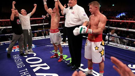 Liam Walsh (right) celebrates beating Gary Sykes on points in their British and Commonwealth super f