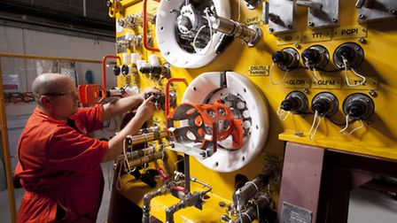 Proserv technician working on subsea control systems