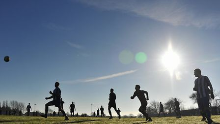Sunday league footballers playing in the winter sun at Rackheath.Picture by SIMON FINLAY.