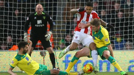 Carlos Cuellar and Michael Turner of Norwich City bring down Andre Gray of Brentford and a penalty i