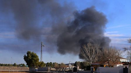 Smoke rises from a military base after a plane crash in Albacete, Spain, Monday, Jan. 26, 2015. Phot