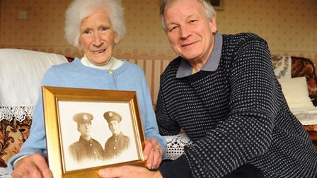 Irene Cutting, aged 101, and her son Graham, with a photograph of Irene's father Ernest Murton, and
