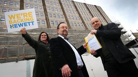 Stephen Little and Joanna Smith hand over the We're Backing Hewett School petition to lead member an