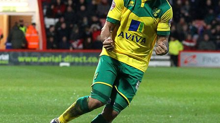 Norwich City's Bradley Johnson shows what it means after Cameron Jerome's match-winner at Bournemout