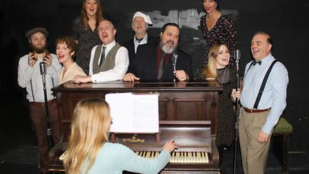 Sewell Barn Theatre rehearse their production of A 1940's Radio Christmas Carol.From left to right: