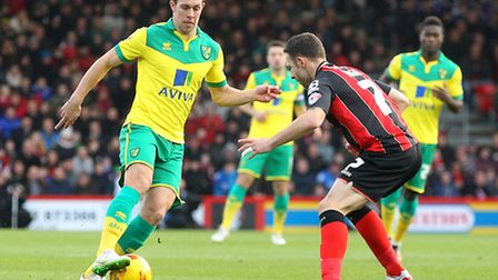 Steven Whittaker of Norwich and Marc Pugh of Bournemouth in action during the match at the Goldsands