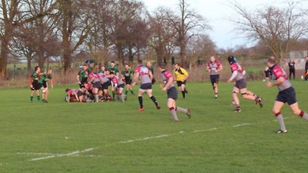 Action from Beccles, green, against West Norfolk.