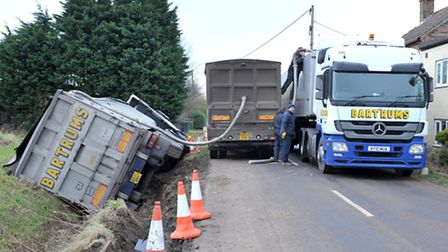 Lorry overturns at Tipps End near Welney. Transferring load from lorry. Picture: Steve Williams