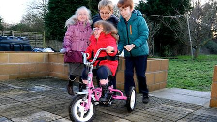 Felicity Wright who has cerebral palsy enjoys her trike friendly play area with her brothers Ben and