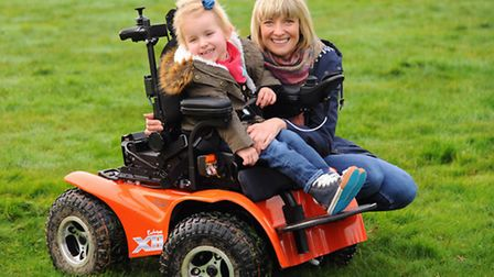 May Haughan-Zelos, 4, in her new electric wheelchair, with mum Emily Haughan at their home at Rought
