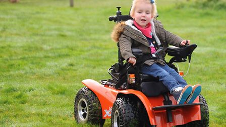May Haughan-Zelos, 4, in her new electric wheelchair at her home at Roughton. Picture: DENISE BRADLE