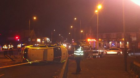 A police car on its side after an accident on Barn Road