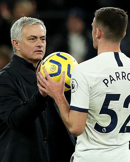 Tottenham Hotspur manager Jose Mourinho (left) gives the matchball to Troy Parrott after the Premier