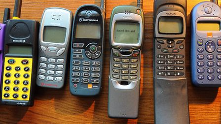 Some of Michael Mould's older mobiles, dating from around 1999. From left, Ericsson T10, early flip