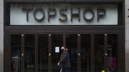 A man walks past the Topshop flagship store at Oxford Circus, London, part of the Arcadia Group. Pic