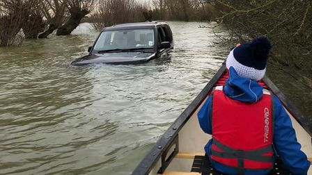 A stranded 4x4 in the flooded Welney Wash.