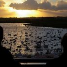 Visitors watching swans shortly after sunrise at Martin Mere