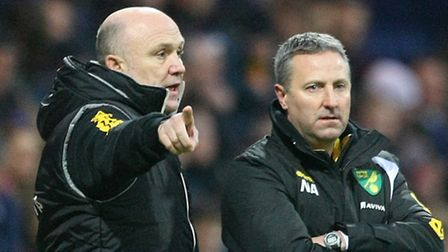 First-team coach Mike Phelan (left) has been placed in caretaker charge of Norwich City following th