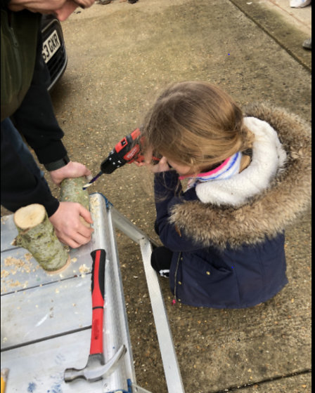 Another pupil creating a 'bug hotel'.