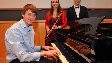 Norfolk Young Musician of the Year winner Alexander Little, left with second place Megan Storerand t