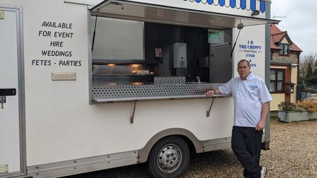 Ian Betts leans on the counter of his fish and chip van.