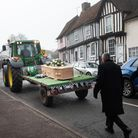People lined the streets of Lavenham to say their goodbyes to David 'Henry' Lane.His coffin was carr