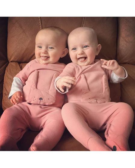 Twins in pink baby grows