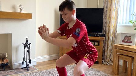 Charlie Barnes is among the pupils at Springwood High School in King's Lynn taking part in an exercise challenge for charity.