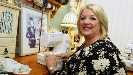Picture of Julie Britton, fromBritton's Bears and Bunting sitting in front of her sewing machine