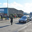 The funeralcortègemakes its past the Harrod UK factory and offices in south Lowestoft, before heading onto a private family funeral service and celebration of RonHarrod's life.