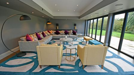 The home cinema with bi fold doors,remote controlled ceiling mounted projector screen andintegral mood lighting