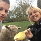 Miss Lodge with her son Lewis and a sheep