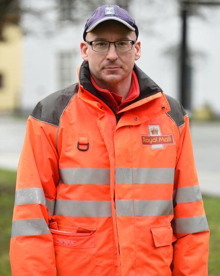 Postman Daniel Goodwin from Bury is trying to raise awareness over hospital transport concerns Pict