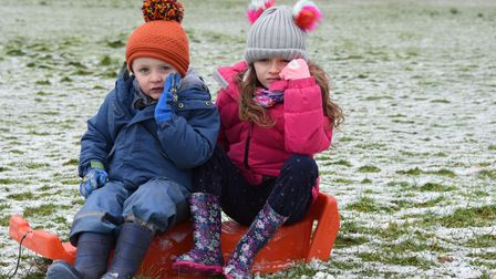 Six-year-old Darcy Andrews and her brother, Cody, three, disappointed with the dusting of snow at At